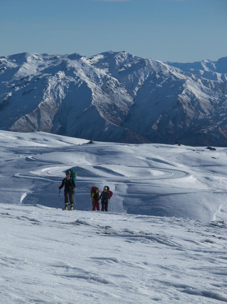 Skinning up in the Pisa Range. Snow Farm behind us.